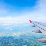 wing-of-an-airplane-with-a-city-background_1232-1308