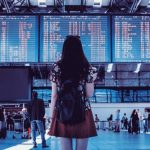 young-woman-with-bag-checking-flight-timetable-in-international-airport_447-19326974
